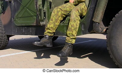 Soldier and his military vehicle - Relaxed soldier in...