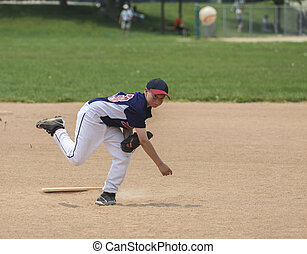 Young male baseball pitcher - Young male baseball player...