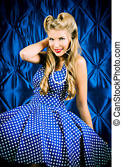 polka-dot dress - Charming pin-up woman with retro hairstyle...