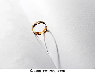 A wedding ring in the middle of the book with heart shape