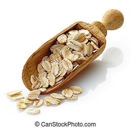 wooden scoop with oat flakes