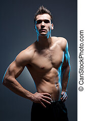 Very fit ripped young athlete - Dark moody portrait of very...