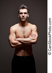 Very fit ripped young athlete. - Dark moody portrait of very...