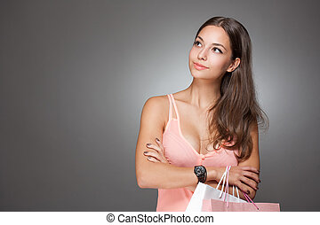 Pink shopping. - Portrait of a brunette beauty with pink and...