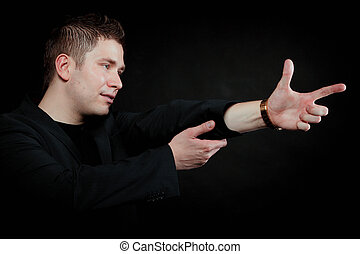 man pointing at something interesting