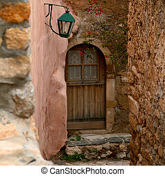 Wooden door in Greece - Wooden door in a Greek town of...