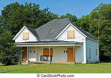 Abandoned House with Boarded up Windows and Doors