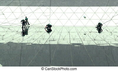 Men washing windows on a skyscraper, high angle from tower