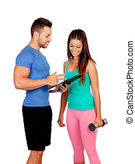 Handsome personal trainer with a attractive girl isolated on...