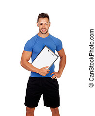 Handsome personal trainer with a clipboard