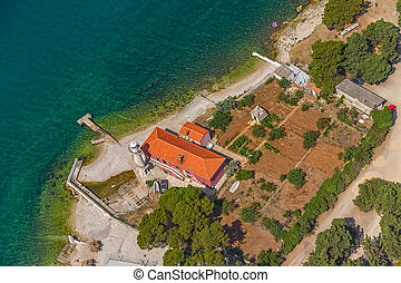 Zadar - Aerial shot of lighthouse near entrance to the Zadar...