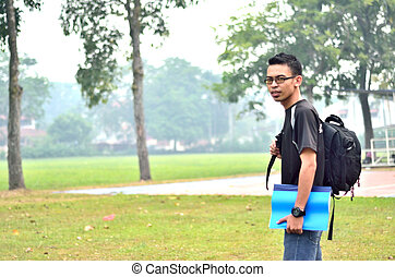 Young male student standing