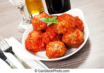 meatballs with sauce - meatballs under meat sauce on white...