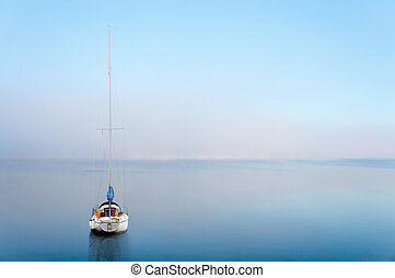 yacht reflected in calm wate