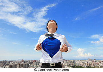 Business man pulling his t-shirt open, showing a superhero...