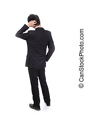 Rear view of young business man confused, isolated over...