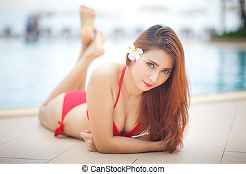 Sexy girl in bikini - Sexy asian girl in red bikini lying...