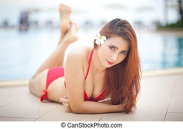 Sexy girl in bikini - Sexy asian girl in red bikini lying...
