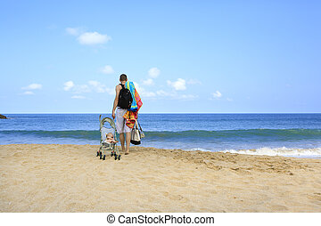 Hands full during vacation with baby - Young father is...