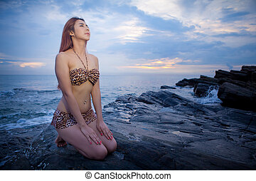 Asian model posing on sunset