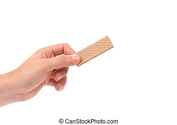 Hand holds wafer of chocolate. Isolated on a white...