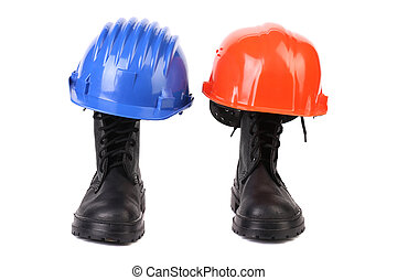 Hard hats and working boots. Isolated on a white background.