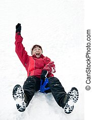 Senior woman on sledge - winter snow activity - Person...