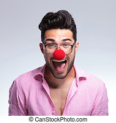 fashion young man shouts with a red nose