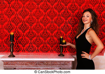 Girl with candles glamour fashion girl in red vintage room...