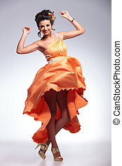 beauty woman dancing with her dress in the air