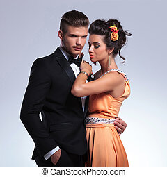 fashion couple with man holding hand in pocket - young...