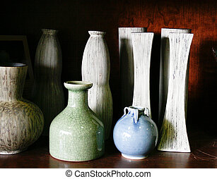 Pottery - Ceramic vases and containers on a shelf.