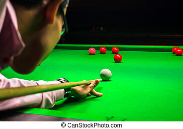Snooker player placing the cue ball for a shot (Focus on...