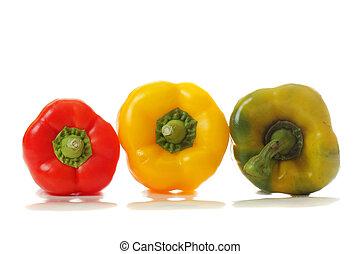 Three paprikas of different colors - Three paprikas...