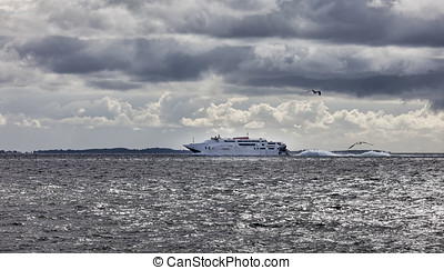 High speed car ferry going out on the ocean