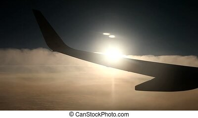 Flight , Sun, Clouds - video footage of a airplane with sun