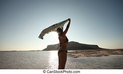 Woman at Beach with towel