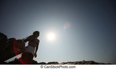 Woman with sunglasses in Sun