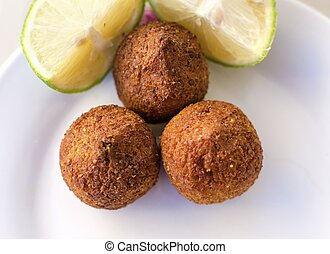 Kebbe - Three small pieces of kebbe, a lebanese dish with...