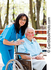 Taking Care of Elder People - Kind doctor, nurse outdoors...