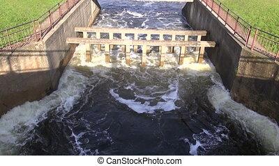 water splash in old river dam