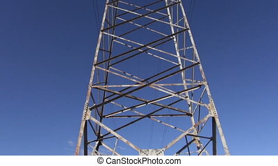 High-voltage electric tower metal construction and camera...