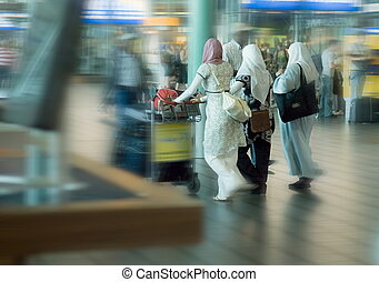 people traveling at the airport - moslim women traveling at...