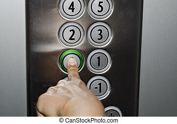 Pushing the button on the elevator - Woman finger pushing...