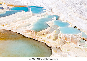 Turquoise water travertine pools at pamukkale - Closeup...