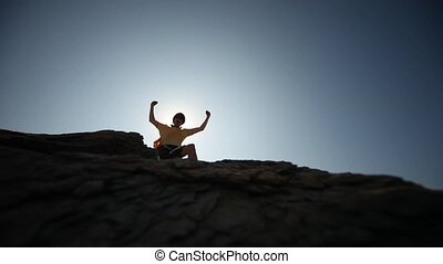 Man on a rock in the sun