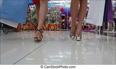 High-heeled shopping - Stylish shopping ladies walking...