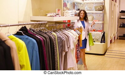 Yellow jacket - Shopping women passing the racks, one of...
