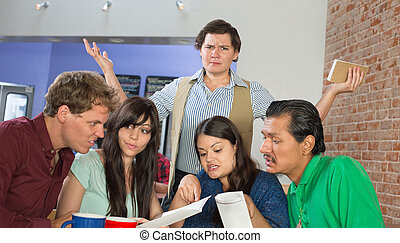 Customers Reading a Menu - Frustrated waitress standing over...