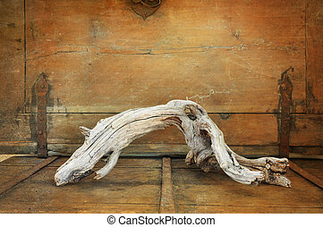 Driftwood - Crooked driftwoood on a bench vintage style.